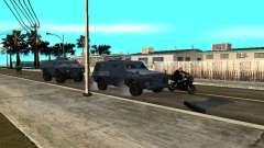 S.W.A.T. and FBI Truck ride through the streets